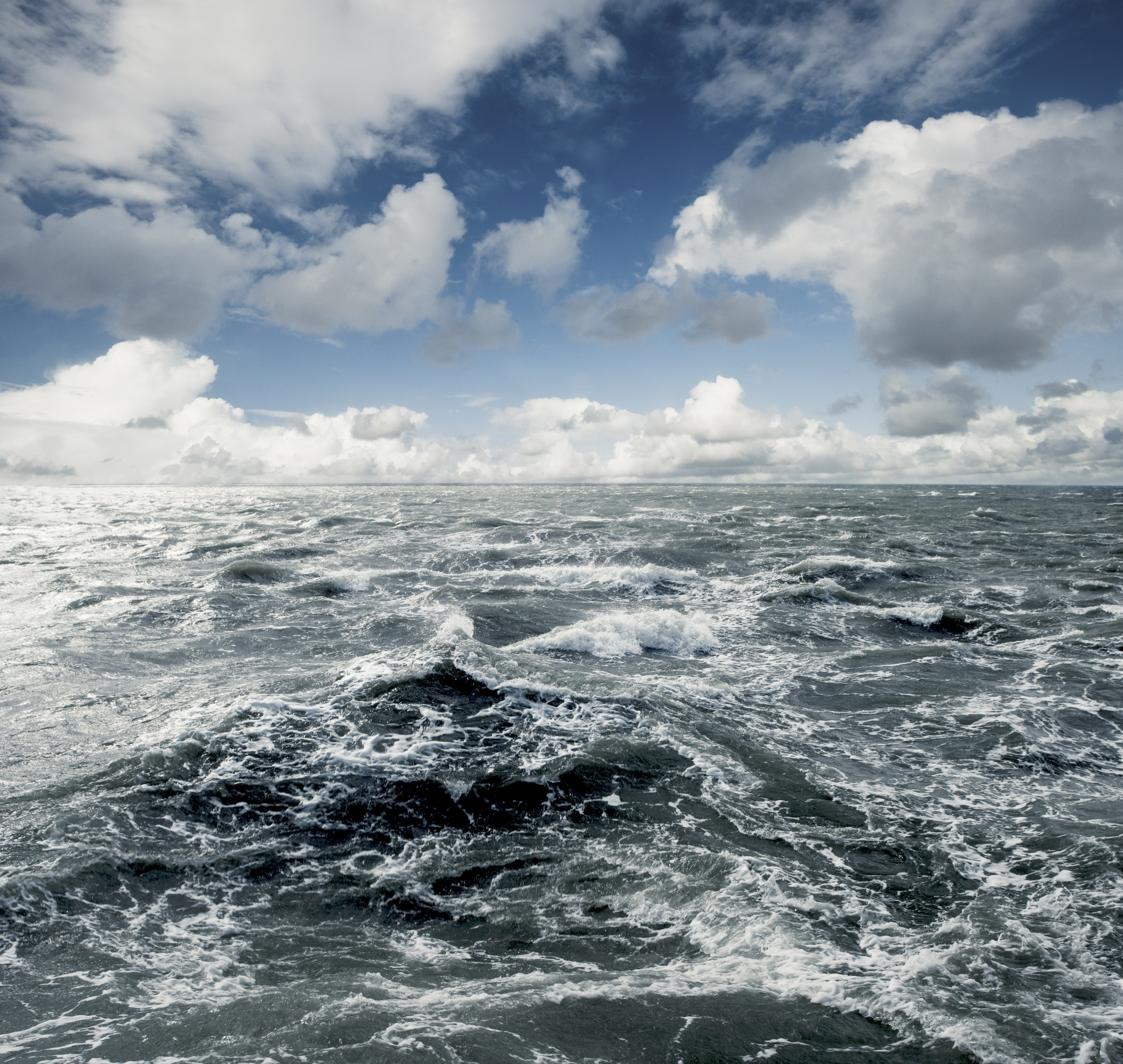 Homepage banner photo of the north sea water and blue cloudy sky