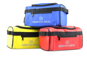 Three North Sea wash bags in red, yellow and blue