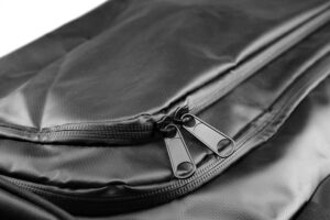 Top pockets of a tarpaulin offshore grab bag. metallic zippers